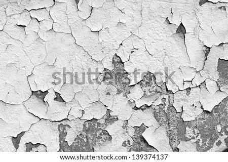 Grungy cracked white wall paint peeling off - stock photo