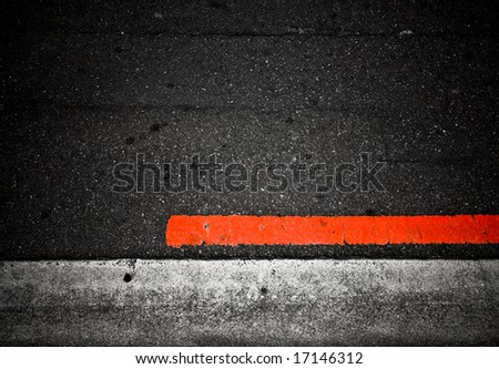 grungy, dirty view of asphalt with distinct red stripe - stock photo