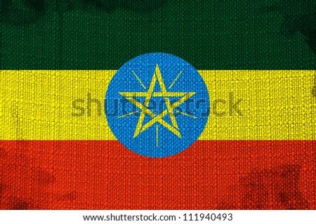 Grungy Ethiopian Flag overlaying a fabric texture - stock photo