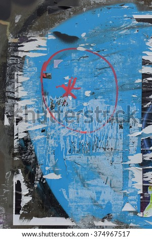 Grungy glass surface stained with torn posters and spray painted colors abstract background. - stock photo