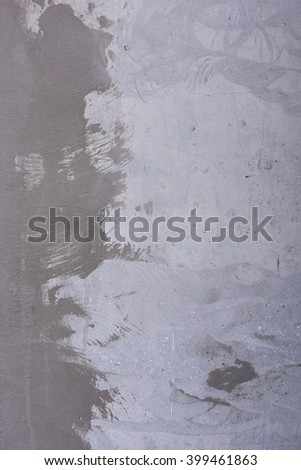 Grungy grey background. Concrete wall with flaws and irregularities. Traces of dark gray cement. Reinforced concrete as a pattern - stock photo