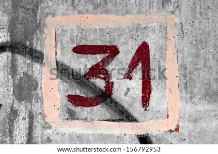 Grungy hand painted number 31. - stock photo