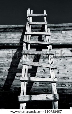 Grungy Ladder and Shadows - stock photo