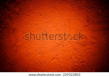 grungy red background texture with dark edges - stock photo