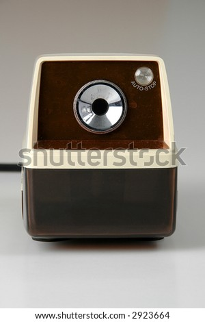 Grungy Retro pencil sharpener over a neutral background. - stock photo