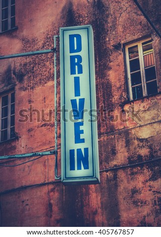 Grungy Retro Sign For A Drive-In Movie Theatre - stock photo