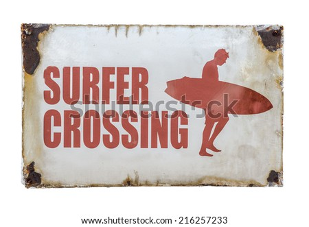 Grungy Retro Vintage Surfer Crossing Sign At A Road Crossing By A Beach - stock photo