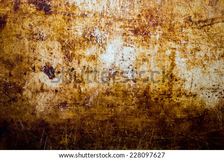 Grungy, scratchy, greasy background with browns. - stock photo
