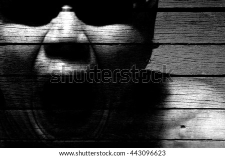 Grungy silhouette illustration of a ghostly apparition of a screaming man.  - stock photo