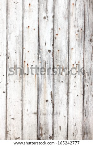 Grungy wooden fence panel with flaking white paint - background - stock photo