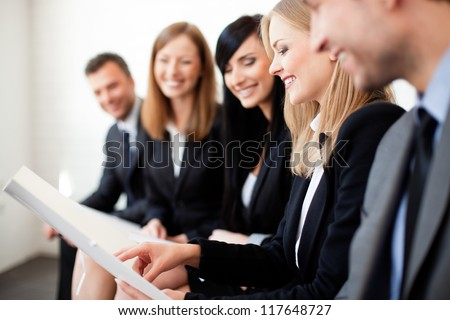 Gruop of business people. Businesswoman explaining - stock photo