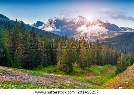 Gruppo Del Cristallo mountain range at foggy summer morning. Dolomites mountains, Italy, Europe. - stock photo