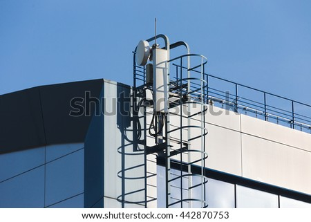GSM and 3G antennas on the rooftop - stock photo