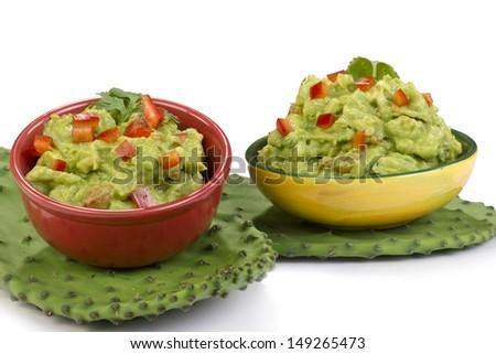 Guacamole dip on green cactus leaf. - stock photo