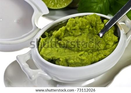 Guacamole in porcelain sauce boat - stock photo