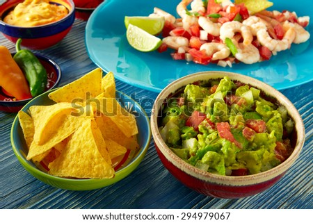 Guacamole mexican food with shrimp ceviche nachos and chili peppers - stock photo