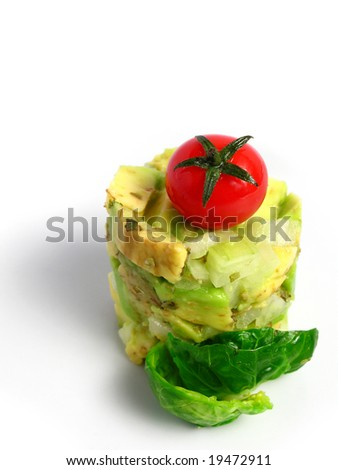 Guacamole tower with cherry tomato on white background - stock photo