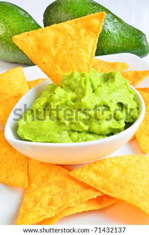 Guacamole with tortilla chips - stock photo
