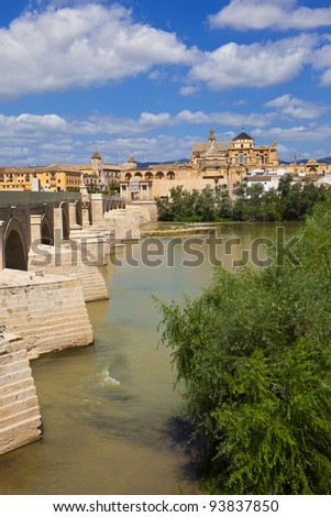 Guadalquivir River passing through Cordoba's Roman bridge with the Mosque-Cathedral as background. Spain - stock photo