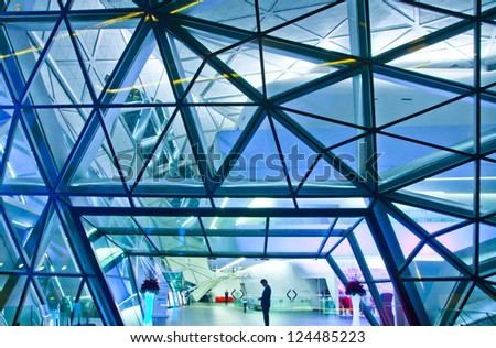 GUANGZHOU, CHINA - DEC.30: Guangzhou Opera House night landscape on Dec. 30, 2012 in Guangzhou, China. Designed by architect Zaha Hadid and has become one of the seven new landmarks in Guangzhou - stock photo