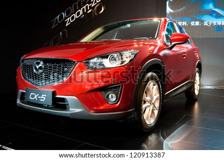 GUANGZHOU, CHINA - DEC 1:mazda CX-5 red car on display at the 10th China(Guangzhou) International Automobile Exhibition. on Dec 1, 2012 in Guangzhou China. - stock photo