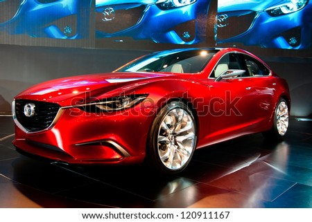 GUANGZHOU, CHINA - DEC 1:MAZDA TAKERI red car on display at the 10th China(Guangzhou) International Automobile Exhibition. on Dec 1, 2012 in Guangzhou China. - stock photo