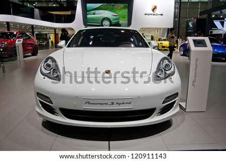 GUANGZHOU, CHINA - DEC 1:PORSCHE PANAMERA white car on display at the 10th China(Guangzhou) International Automobile Exhibition. on Dec 1, 2012 in Guangzhou China. - stock photo