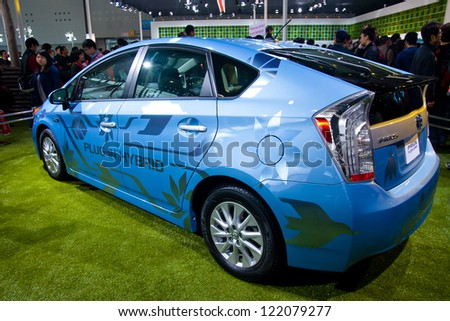 GUANGZHOU, CHINA - DEC 1:Toyota Prius plug-in hybrid on display at the 10th China(Guangzhou) International Automobile Exhibition. on Dec 1, 2012 in Guangzhou China. - stock photo