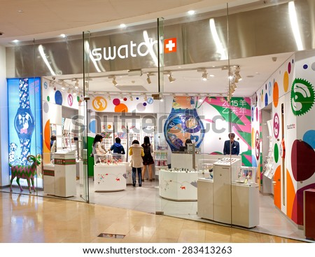 GUANGZHOU, CHINA-FEB. 23, 2015: Unidentified people are seen at a swatch store. Swatch SA, founded in 1983, is specialized in watch manufacturing and one of the biggest brand names in the world.   - stock photo