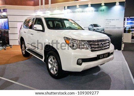 GUANGZHOU, CHINA - JUL 29: LEXUS GX400 car on 2012 Guangzhou Imported Luxury Automobile Exhibition,on July 29, 2012 in Guangzhou China,This is a large international car exhibition - stock photo