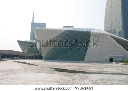GUANGZHOU, CHINA - MAR.24: Guangzhou Opera House night landscape on Mar. 24, 2012 in Guangzhou, China. Designed by architect Zaha Hadid and has become one of the seven new landmarks in Guangzhou - stock photo