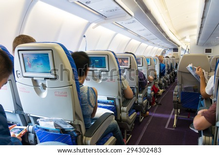 GUANGZHOU, CHINA - MAY 10, 2015: Interior of a China Southern Airlines Company Limited (CSN) commercial airplane. It is the largest airline company in China and is founded in 1995 - stock photo