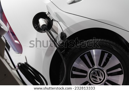 GUANGZHOU, CHINA - NOV. 20. 2014:Full electric car Volkswagen Electric Up on the 12th China International Automobile Exhibition in Guangzhou, Guangdong province. - stock photo