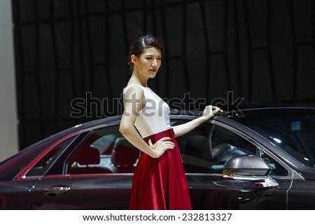 GUANGZHOU, CHINA - NOV. 22. 2014: Model posing during the 12th China International Automobile Exhibition in Guangzhou, Guangdong province. - stock photo