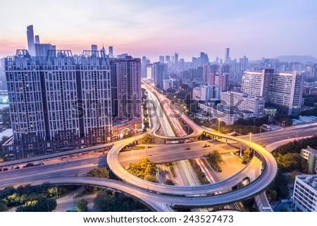 guangzhou huangpu interchange in twilight with city skyline - stock photo