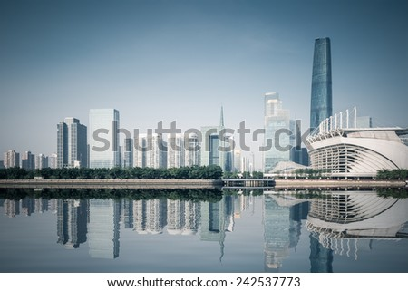 guangzhou skyline with reflection, beautiful pearl river new town ,China - stock photo