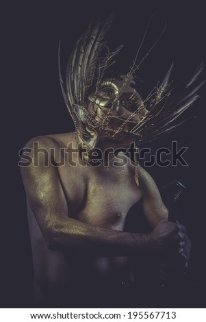 Guard, golden deity, man with wings and gold helmet - stock photo