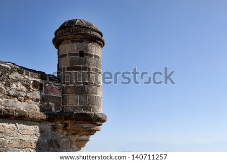 Guard post at the restored Fort Matanzas National Monument in North Florida in the USA. The image shows the Spanish style stone guard shack silhouetted against a bright blue sky. - stock photo