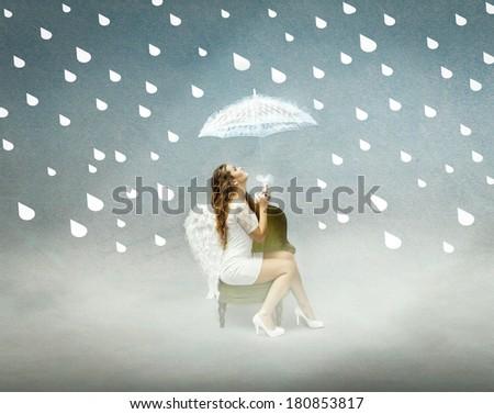 guardian angel under rain. - stock photo