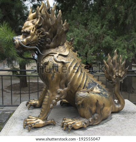 Guardian statue in the garden of a palace, Forbidden City, Xicheng District, Beijing, China - stock photo