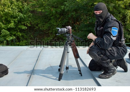guarding VIPs, special forces policeman on the roof, observer - stock photo