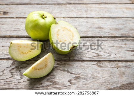 Guava fruit cut on wooden - stock photo