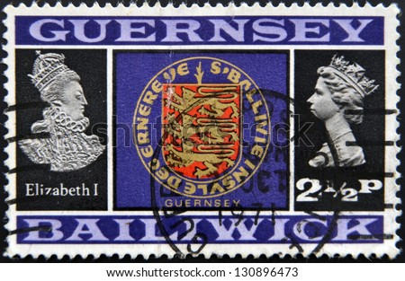 GUERNSEY - CIRCA 1971: Stamp printed in Guernsey shows Elizabeth I, shield and Elizabeth II, circa 1971 - stock photo