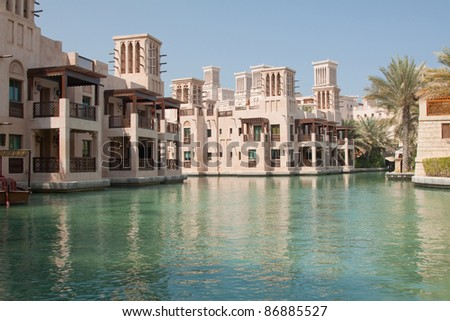 Guest rooms at the Madinat Jumeirah hotel, Dubai, overlooking the Abra waterway system - stock photo