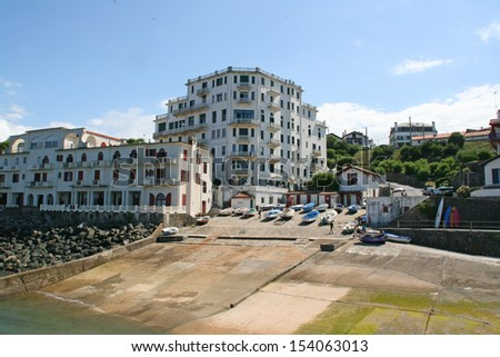 Guethary harbor, Pays Basque, France.Guethary is located between Bidart and Saint Jean de Luz. Picture shot from the jetty. - stock photo