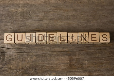 GUIDELINES text on wooden cubes - stock photo