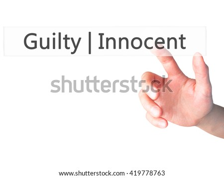 Guilty Innocent - Hand pressing a button on blurred background concept . Business, technology, internet concept. Stock Photo - stock photo