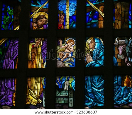 GUIMARAES, PORTUGAL - AUGUST 7, 2014: Stained glass window depicting a nativity scene in the Sanctuary of the Rock (Santuario da Penha) in Guimaraes, Portugal.  - stock photo