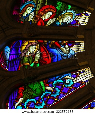 GUIMARAES, PORTUGAL - AUGUST 7, 2014: Stained glass window depicting angels in the Sanctuary of the Rock (Santuario da Penha) in Guimaraes, Portugal.  - stock photo