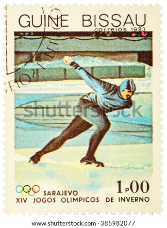 GUINEA-BISSAU - CIRCA 1983: stamp printed in Guinea-Bissau shows running skater, devoted to the 14th Winter Olympics in Sarajevo, series, circa 1983 - stock photo